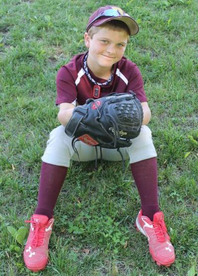 Custom glove making big difference for De Soto youth baseball player
