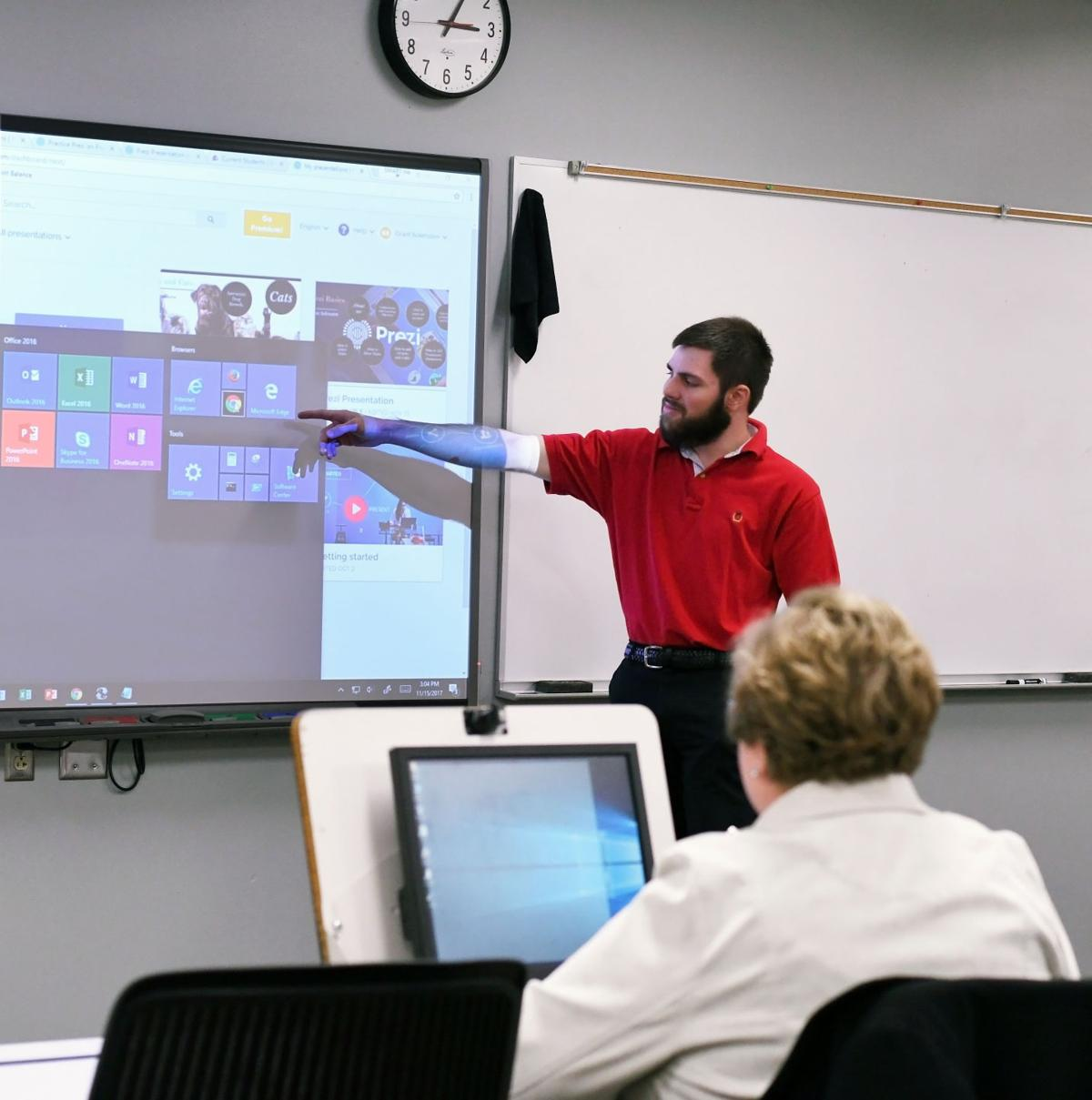 It students at western technical college teach while they learn western it student grand solensten leads a class of community members and other participants demonstrating how to create a presentation using prezi thecheapjerseys Images