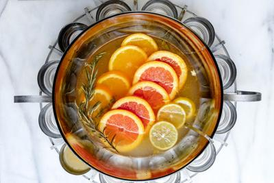 T​oast the new year with this rosemary and citrus champagne punch