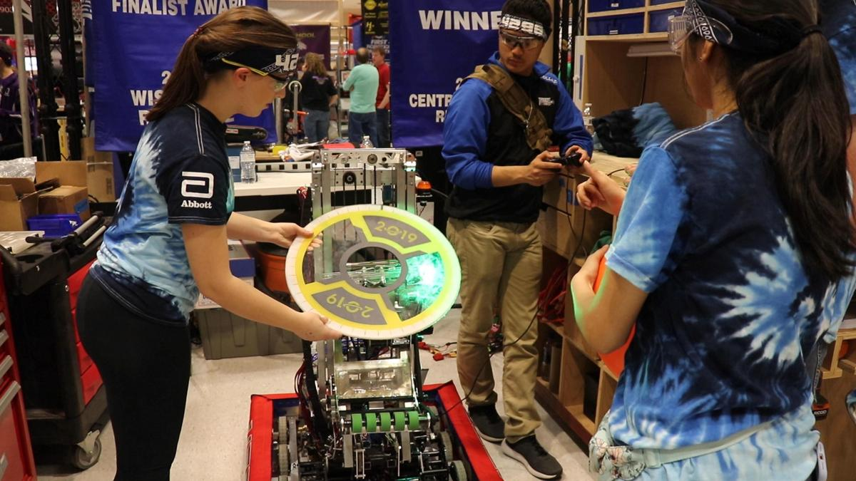 Alyssa and Janhvi demonstrating how their robot works