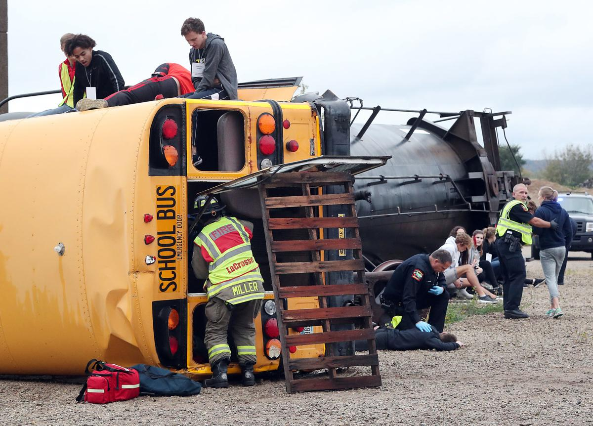 Removing victims from overturned bus in crisis drill