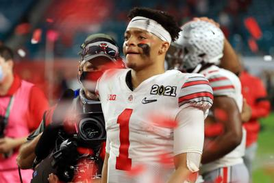 In this photo from January 11, 2021, Justin Fields of the Ohio State Buckeyes leaves the field following the College Football Playoff National Championship game against the Alabama Crimson Tide at Hard Rock Stadium in Miami Gardens, Florida.