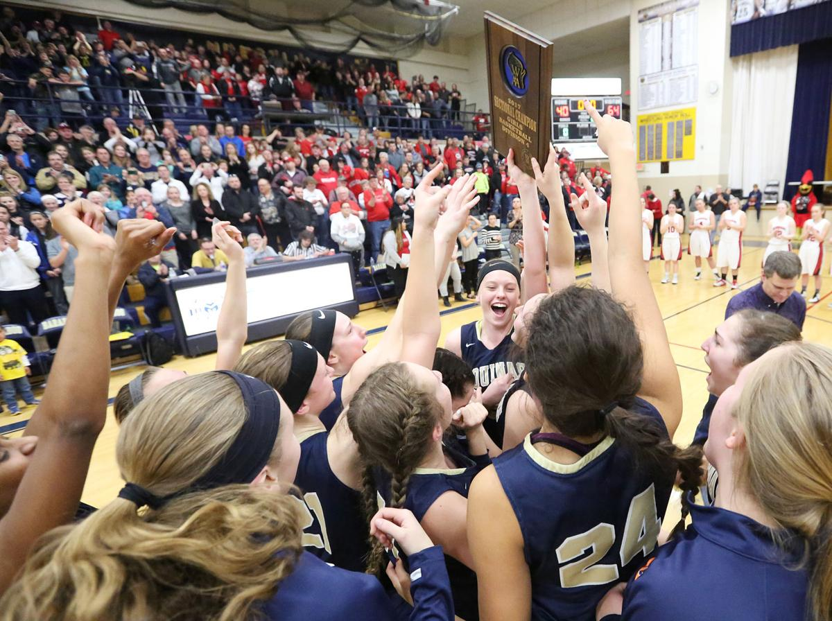 Aquinas girls basketball sectional celebration