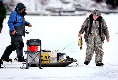 Ice angler with bass