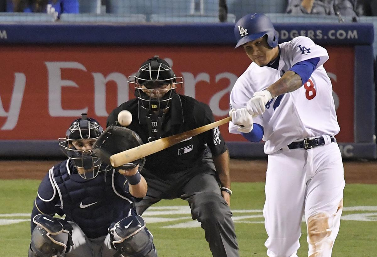 Manny Machado homers against Brewers, AP photo