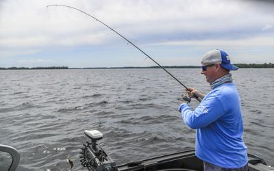 Catch Your Moment Foundation founder and cancer survivor Timmon Lund of Duluth plays a fish on Island Lake north of Duluth July 14, 2020. Catch Your Moment gives cancer patients the chance to go on fishing trips.