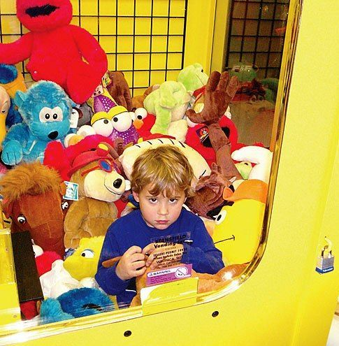 Kid trapped in claw machine