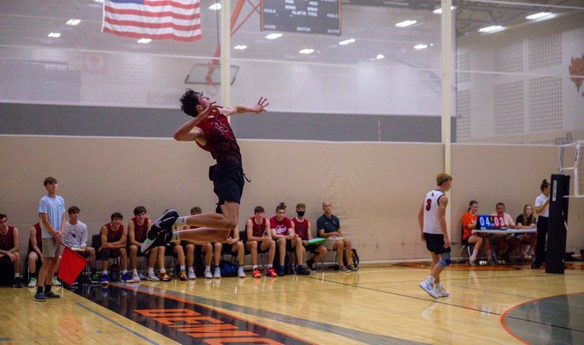 Cole jump serving.jpg