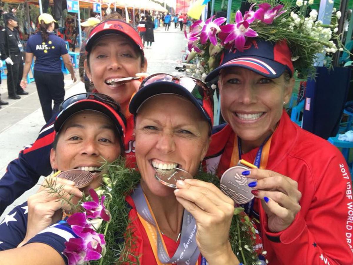 Lori Freit-Hammes bites medal
