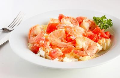 Greek orzo salad with shrimp and cherry tomatoes
