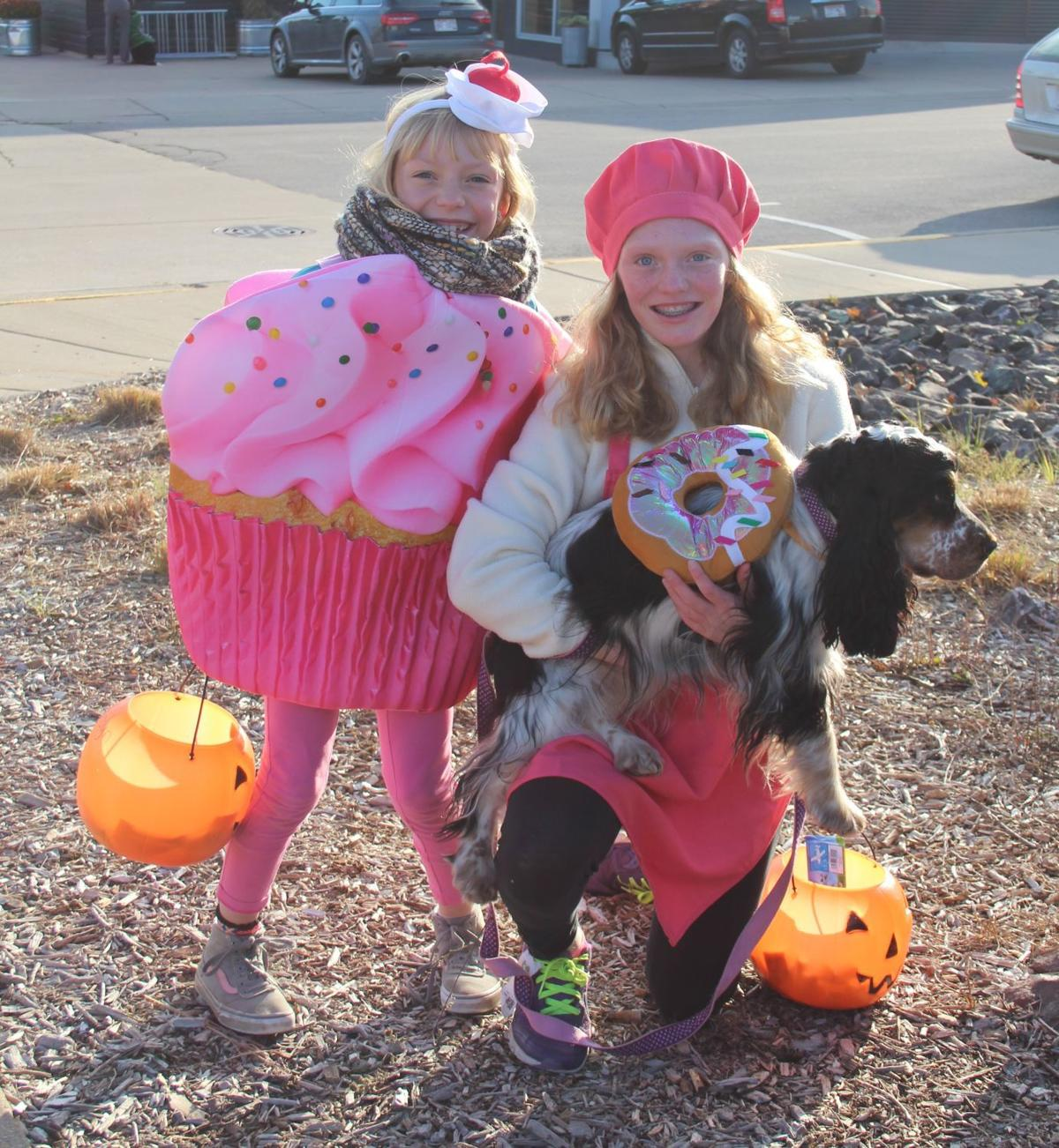 Costumed kids and their dog