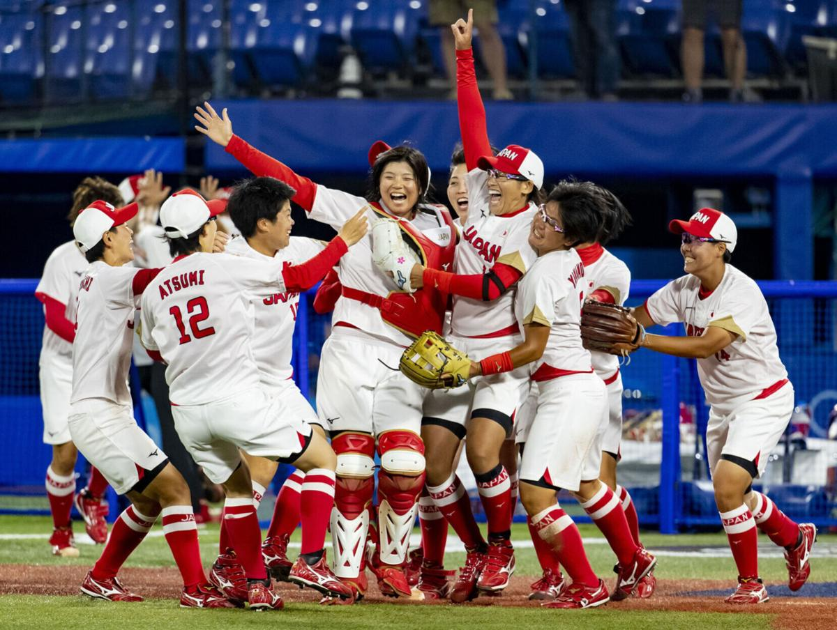 Japan celebrates as they win the the gold medal in softball over the United States on Tuesday, July 27, 2021 in the gold medal game at Yokohama Baseball Stadium during the Tokyo Olympics.