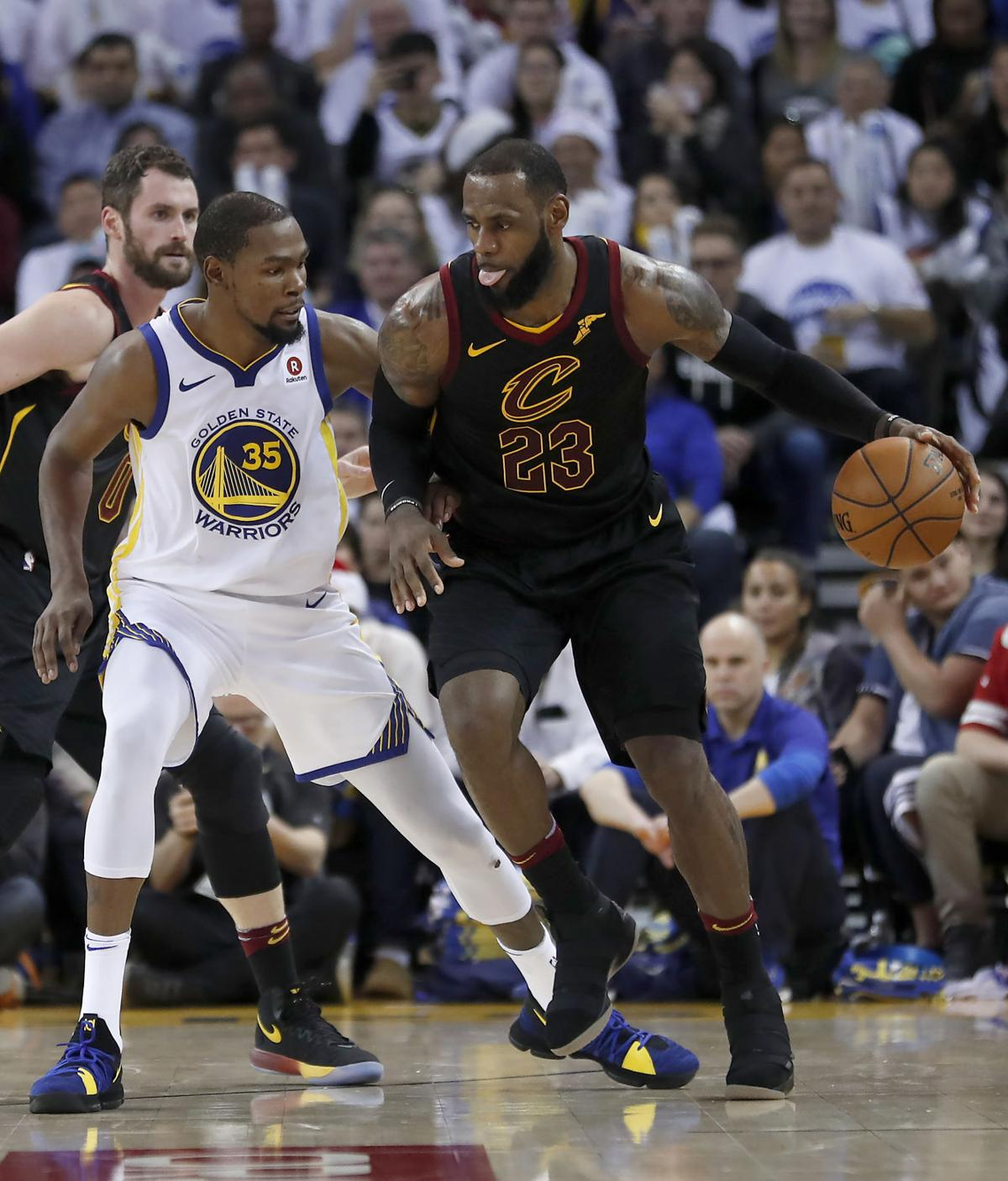 c21363783cf Cleveland Cavaliers forward LeBron James (23) moves the ball around Golden  State Warriors forward Kevin Durant (35) during the second half of Monday s  game ...