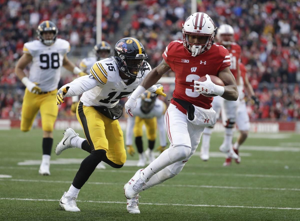 Defense carries No. 6 Wisconsin past No. 25 Iowa 38-14 ...
