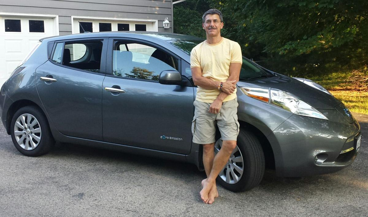 Stoughton man with Nissan Leaf electric vehicle, submitted photo