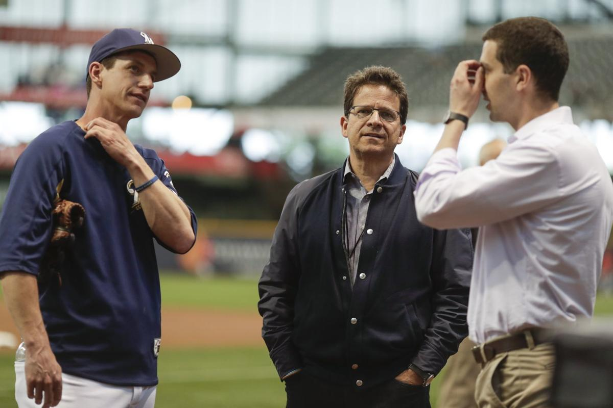 Craig Counsell, Mark Attanasio, David Stearns, AP generic file photo
