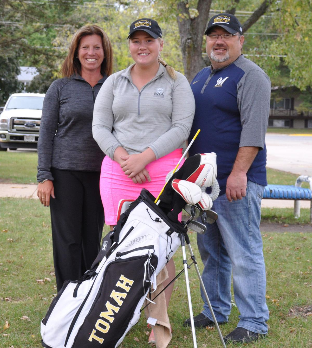 Molly Larsen and coaches