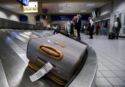 Luggage circles a baggage claim at Gate C on March 10, 2017, at DFW International Airport in Dallas, Texas.