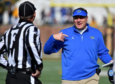 Head coach Dan Mullen of the Florida Gators talks with an official after a penalty call during the second quarter of a game against the Missouri Tigers on Nov. 16, 2019 at Faurot Field/Memorial Stadium in Columbia, Mo.