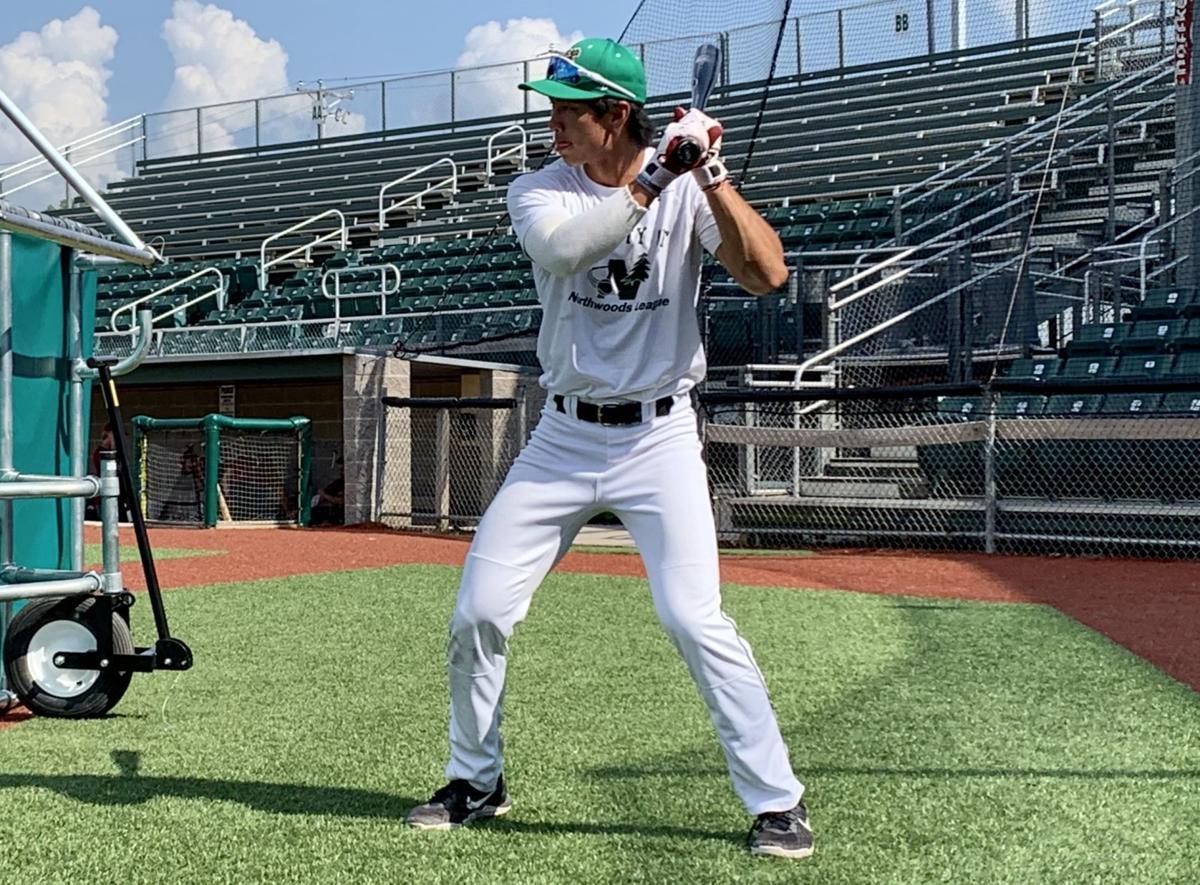 Kobe Kato works on his swing