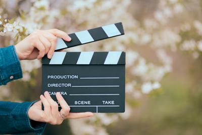 hands holding film slate cinema clapper