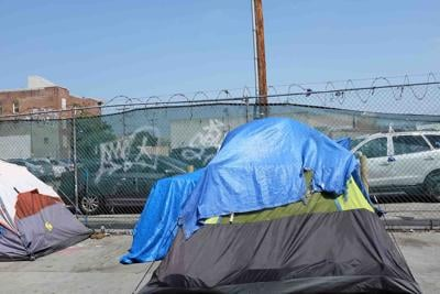 Tents set up by Homeless people on the sidewalk in the Skid Row area of Los Angles.