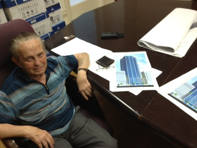 Joseph Hellen with Renderings for his Proposed 40-story Tower