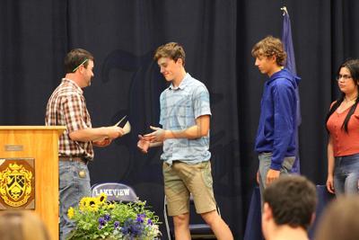 Anders Erickson receives an award