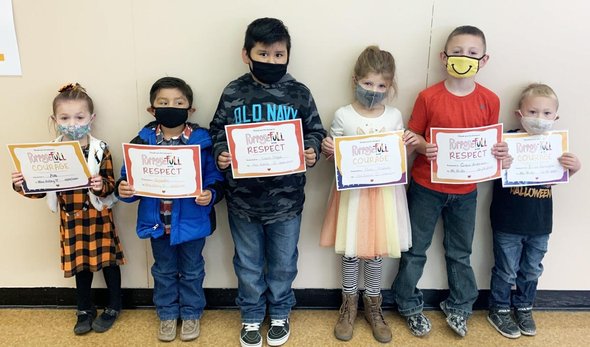 Students proudly display awards for respect, behavior