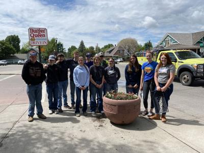 Students plant flowers to beautify downtown