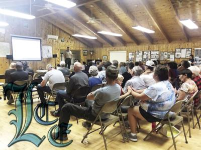 Fire Continues to Gain Momentum Watson Creek Fire meeting held