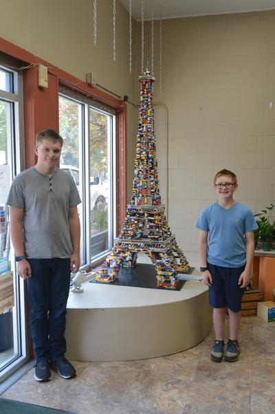 Lego 8-foot Eiffel Tower on display at Back Yard Floral