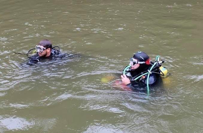 Divers Prepare To Dive In 'Skinny Dip Cove'