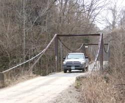 Unveil forgotten landmarks with a drive to swinging bridges