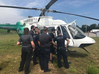 Emergency Service Workers Learn About New Helicopters At The Lake