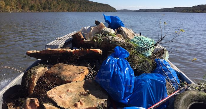Boat Piled High With Trash Pulled From The Lake Of The Ozarks