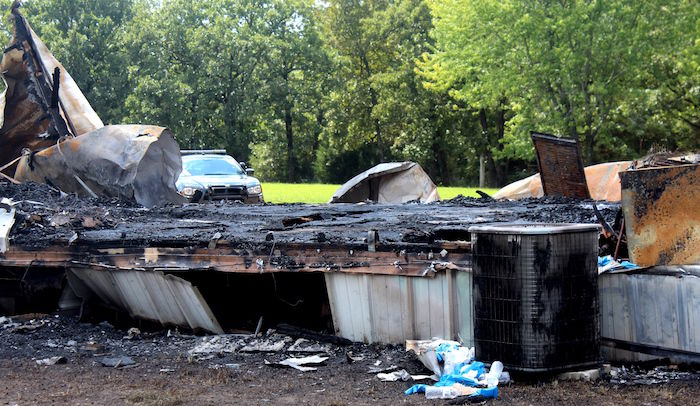 Charred Remains Of Mobile Home After Fire