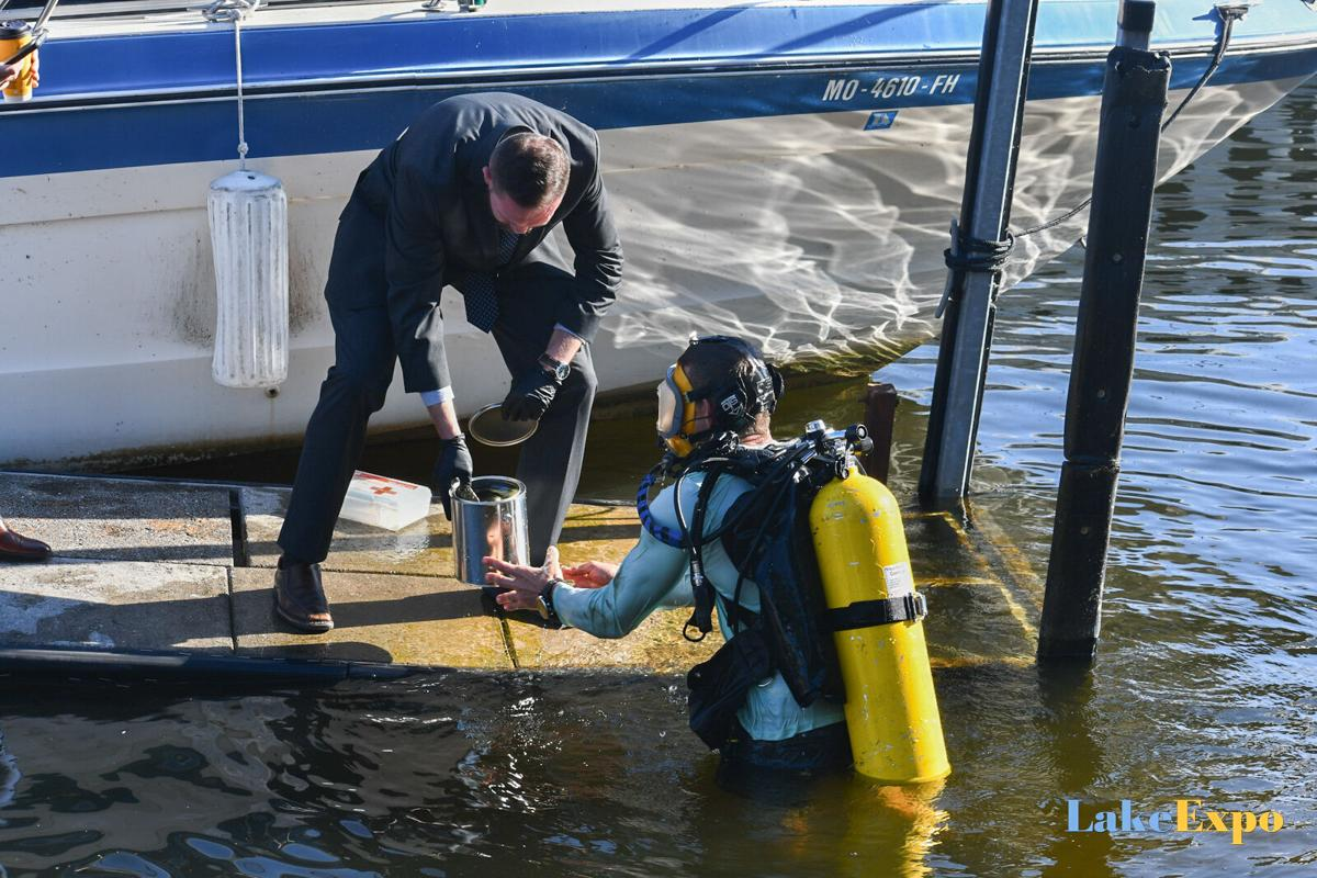 Diver Retrieves Gun From Water