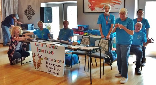 Volunteers at the Idiots Club fundraising table
