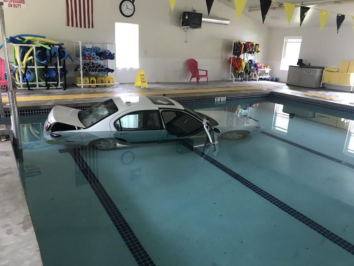 Car Crashes Into Lake West Aquatic Center Pool