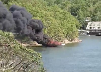 Boat On Fire Near Grand Glaize Bridge