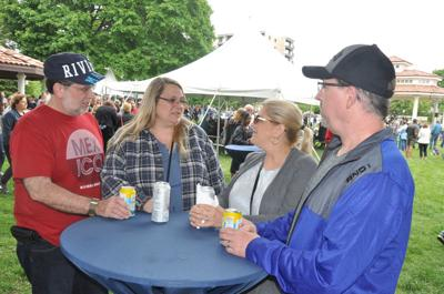 Mike Bransky, Bonnie Bransky, Brandy Wells and Mike Wells share a laugh during Taste of Lake Geneva