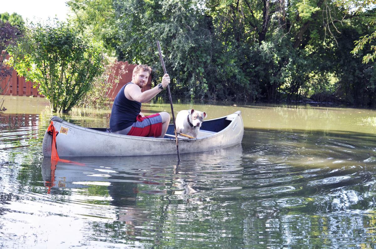 Dillan Schneider man in canoe flood