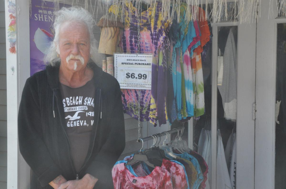 Bob Lee, owner of Bob's Beach Shack, stands next to some of the merchandise he has displayed outside his business