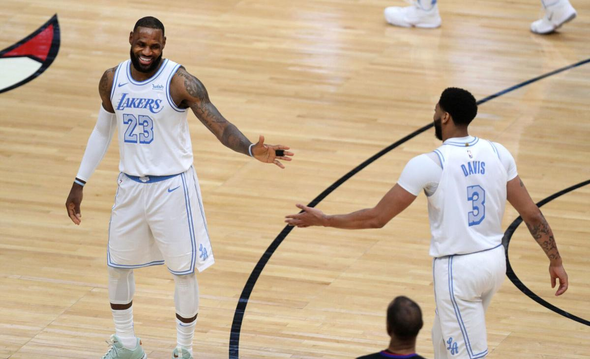 Los Angeles Lakers forwards LeBron James and Anthony Davis celebrate in the second half against the Chicago Bulls at the United Center in Chicago on Saturday, January 23, 2021.