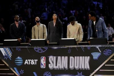 The panel of Dwyane Wade, Common, Candace Parker, Chadwick Boseman, and Scottie Pippen look on in the 2020 NBA All-Star- AT&T Slam Dunk Contest during State Farm All-Star Saturday Night at the United Center in Chicago on February 15, 2020.