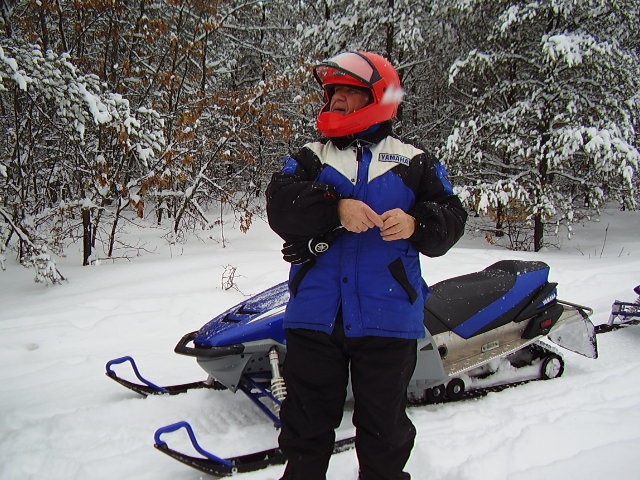 Don Holden with snowmobile