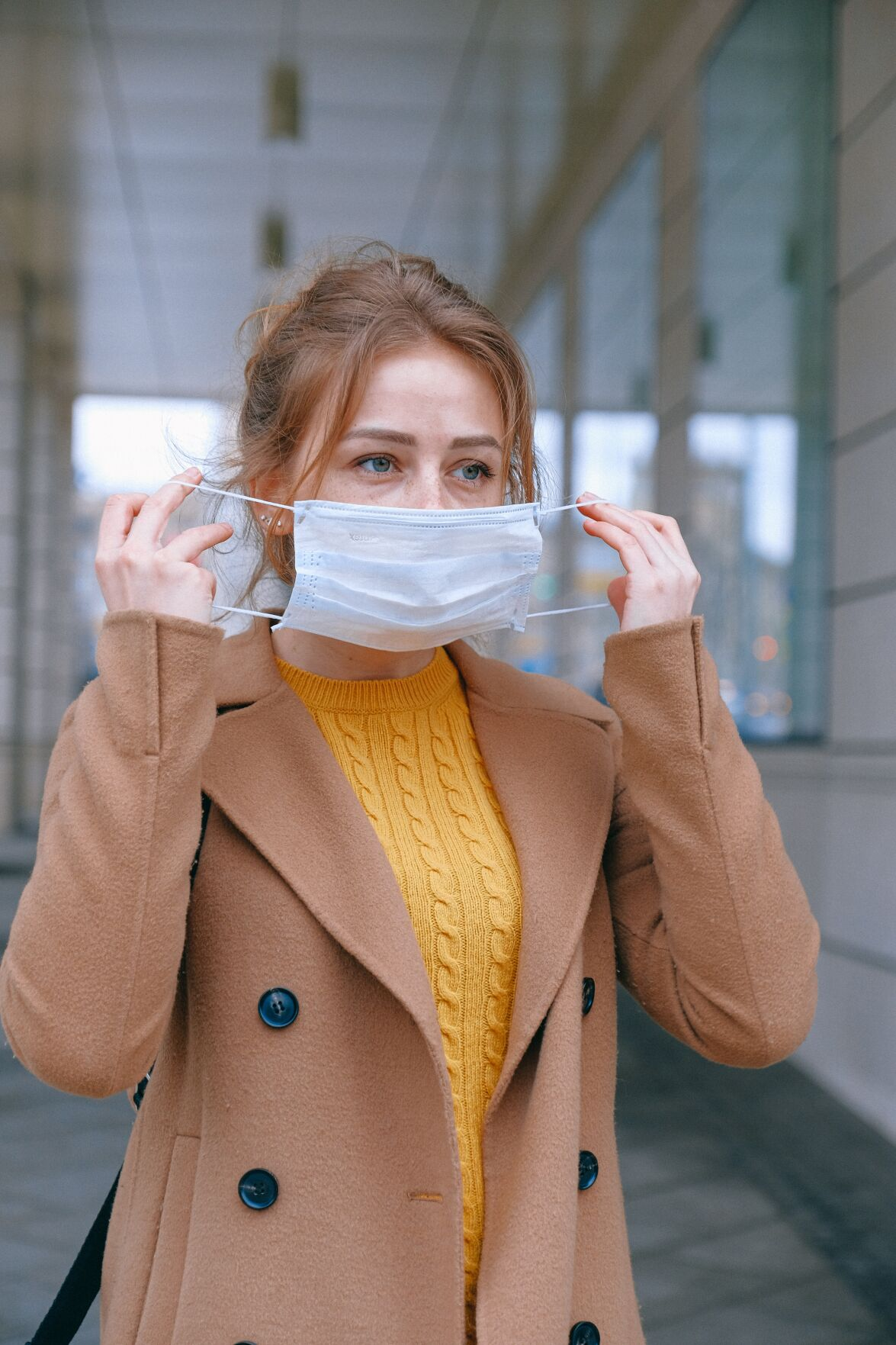 Woman putting on mask stock photo