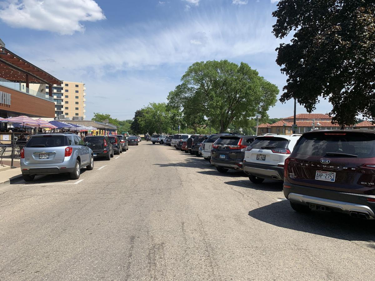 Many vehicles are parked along Wrigley Drive during a weekday afternoon