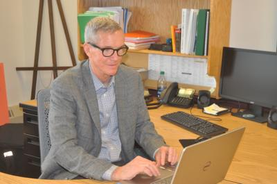 Mayor Tom Hartz works at his desk